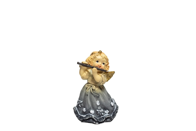 Statuette of an angel girl with a flute isolated on a white background
