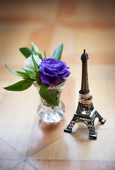 Statuette of eiffel tower and wedding rings