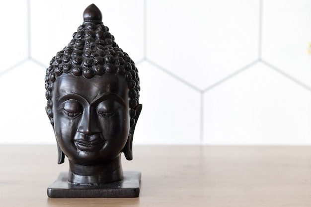 Statuette head of buddha, space for text