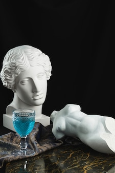 Statuettes with a glass of alcohol