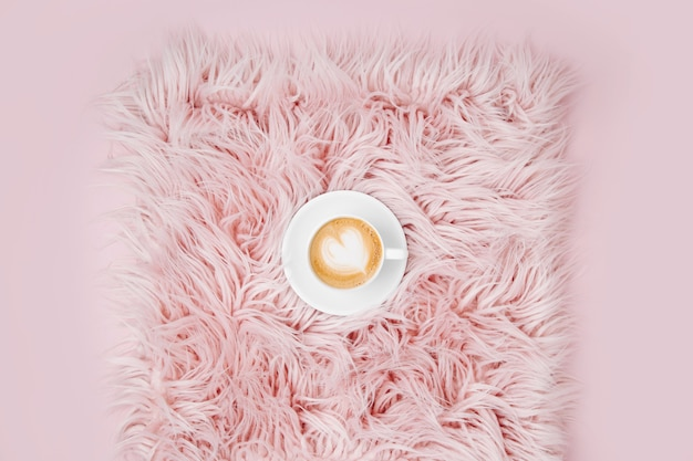 Stay home, quarantine. working from home. cup of coffee on the fluffy fur plaid.  flat lay, top view