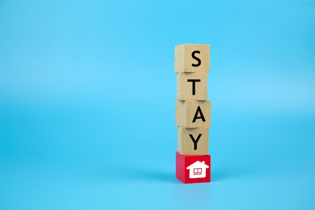 Stay home stay safe icons on wooden toy block.concepts for health and medical prevention of coronavirus or covid-19 infection, social distancing and work from home.