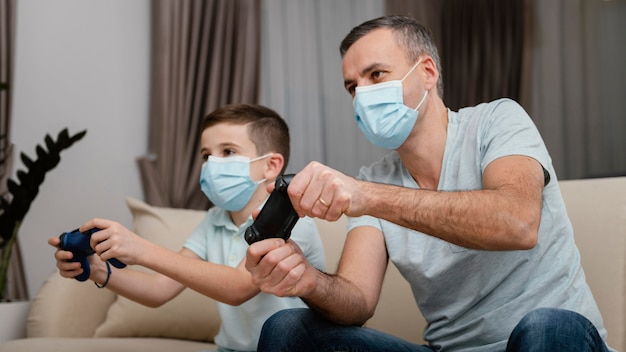 Stay indoors man and kid wearing medical masks