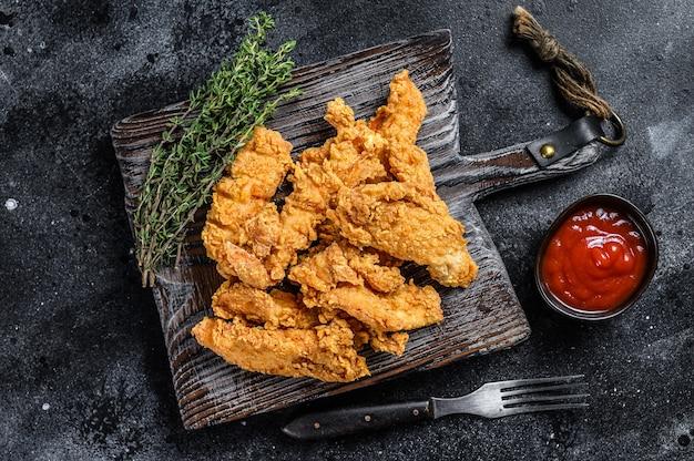 Steak fingers fried breaded chicken breast strips
