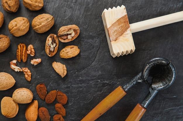 Steak hammer, nutcracker and nuts