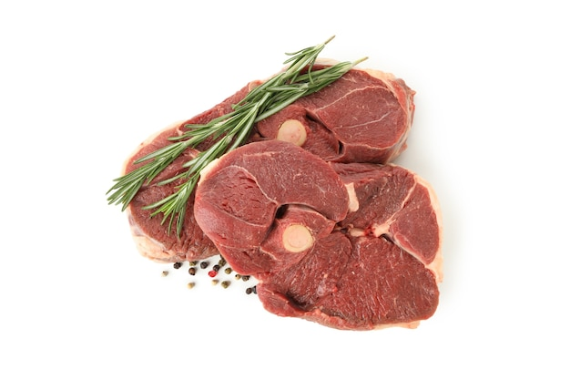 Steak meat with herbs and spices isolated on white