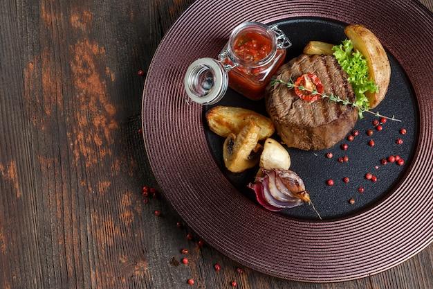 Steak medallion. restaurant food. wood background