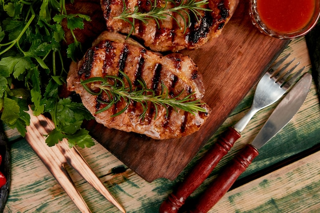 Steak pork grill on wooden cutting board