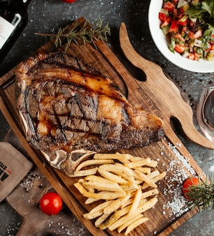 Steak served with french fries and salad