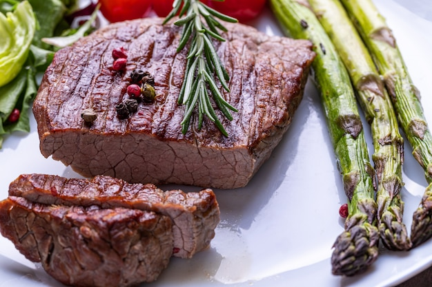 Steak on a white plate with vegetables