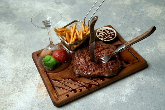 Steak with fries and vegetables