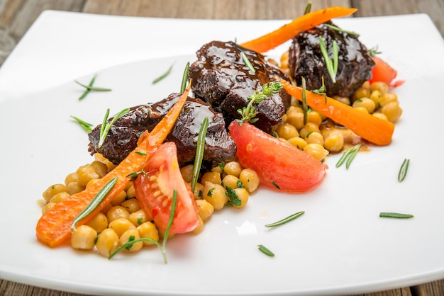 Steak with pear and chickpeas