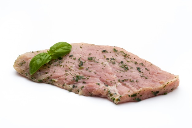 Steak with spices isolated on white background.