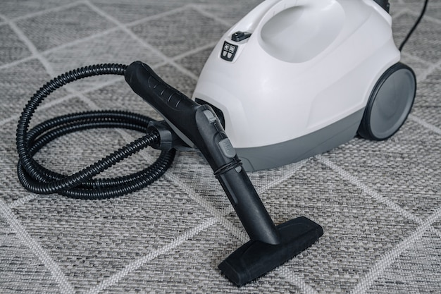 Steam cleaner on the carpet