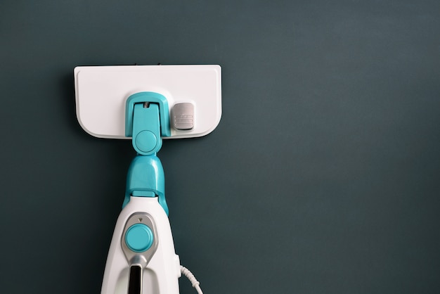 Steam cleaner mop on grey background.