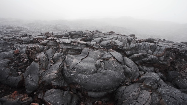 The steam coming out of the cracks of volcanic lava layer tolbachik volcano kamchatka russia