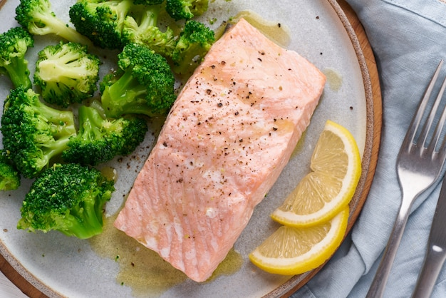Steam salmon, broccoli, paleo, keto, lshf or dash diet. mediterranean food. clean eating, balanced