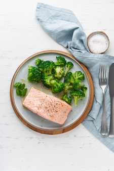 Steam salmon and vegetables, broccoli, paleo, keto, lshf or dash diet. mediterranean food