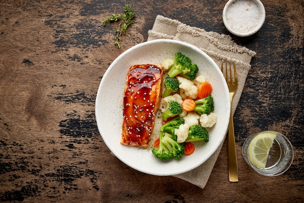 Steam salmon and vegetables, mediterranean food with steamed fish.
