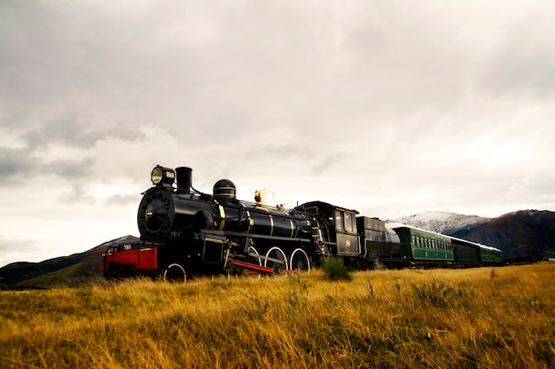 Steam train in a open countryside.