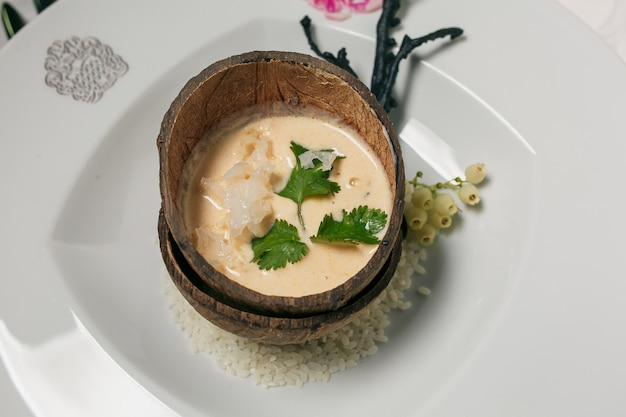 Steamed brown sticky rice in coconut shell, thai traditional food.