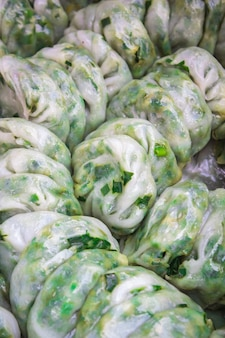 Steamed dumpling stuffed with garlic chives, kanom kuicheai.