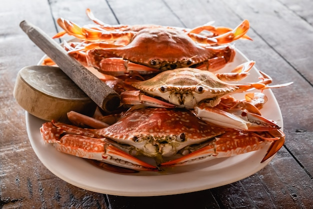 Steamed flower crabs in the dish on wooden table