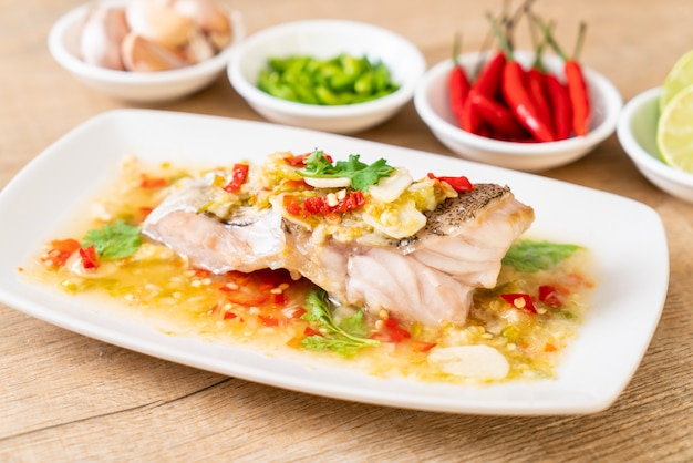 Steamed grouper fish fillet with chili lime sauce in lime dressing