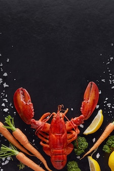 Steamed lobster prepared on black background with copyspace