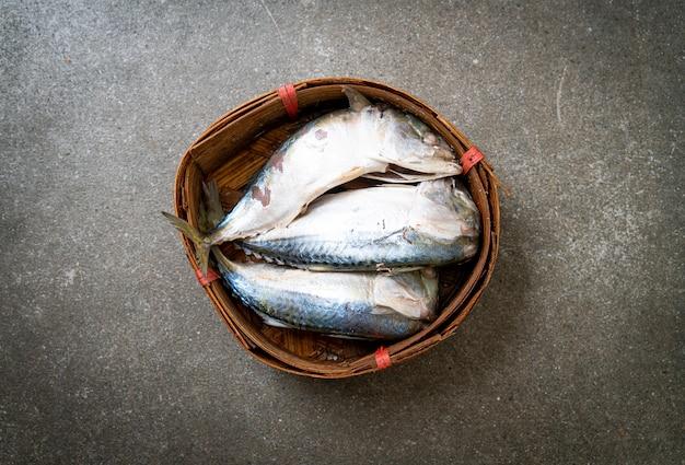 Steamed mackerel fish in bamboo basket