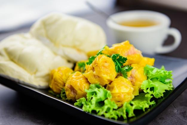 Steamed pork dumpling, steamed dumplings and hot tea, asian food