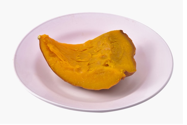 Steamed pumpkin in plate isolated on white background.