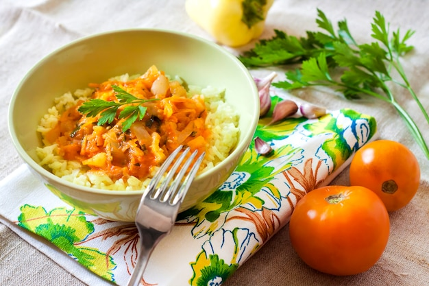 Steamed rice with stewed vegetables and turmeric