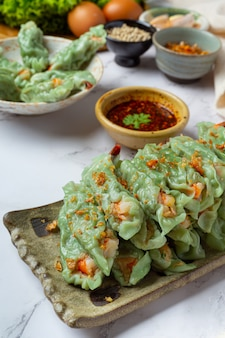 Steamed shrimp wontons dim sum with raw materials. Free Photo