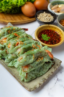 Steamed shrimp wontons dim sum with raw materials.
