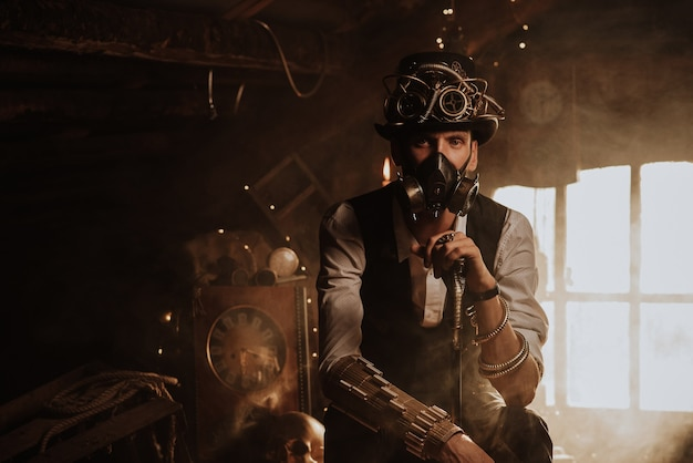 Steampunk cosplay. portrait of a man in a top hat, glasses and a gas mask with a cane in his hand