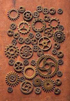 Стимпанк механические зубчатые колеса шестерни на деревянных фоне