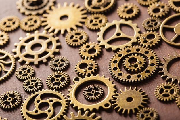 Steampunk mechanical cogs gears wheels on wooden background