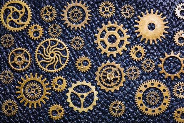 Steampunk mechanical gears on leather surface