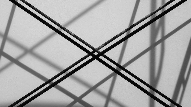 Steel bar with shadow on the wall