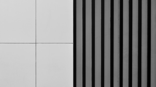 Steel battens and square metal wall. - monochrome