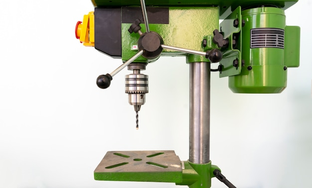 A  steel  bench drill machine in the factory isolated, working process