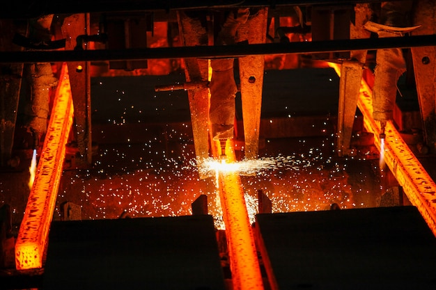 Steel billets at torch cutting in metallurgical plant. metallurgical production, heavy industry, engineering, steelmaking.