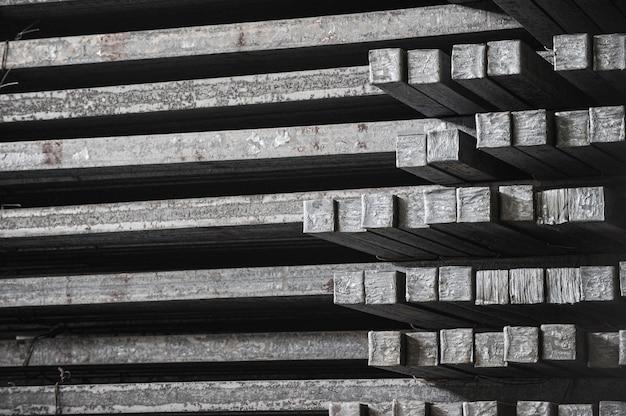 Steel billets in the warehouse of metallurgical factory. hot ingot in a steel plant.
