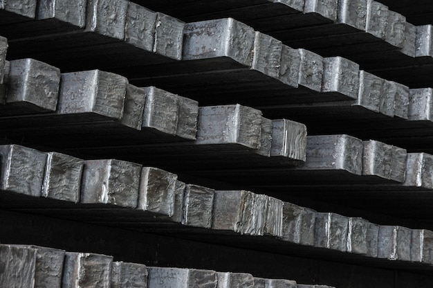 Steel billets in the warehouse of metallurgical factory.