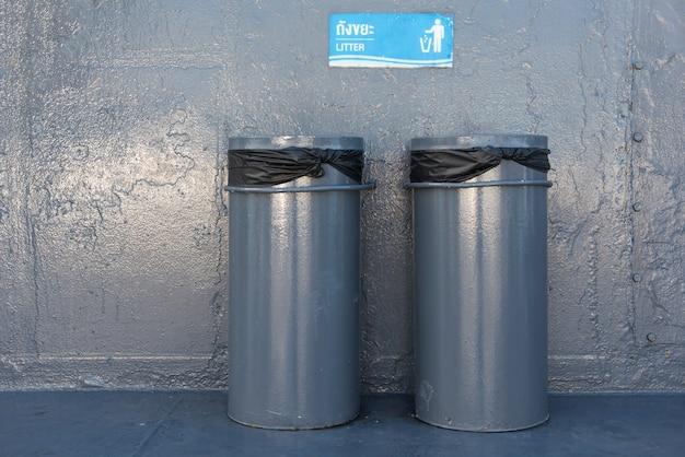 Steel garbages on metal floor background