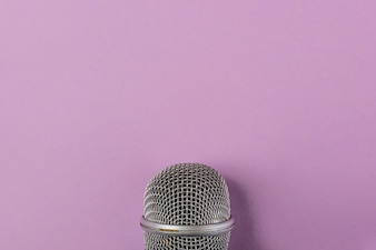 Steel grille close-up of the microphone on purple background