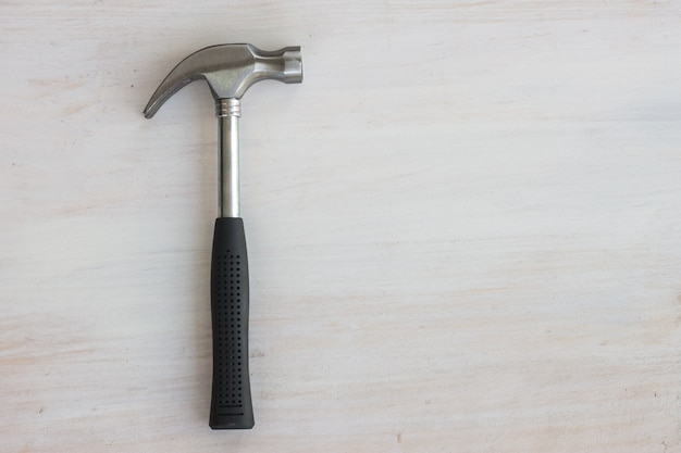 Steel hammer rubble handle on white wood