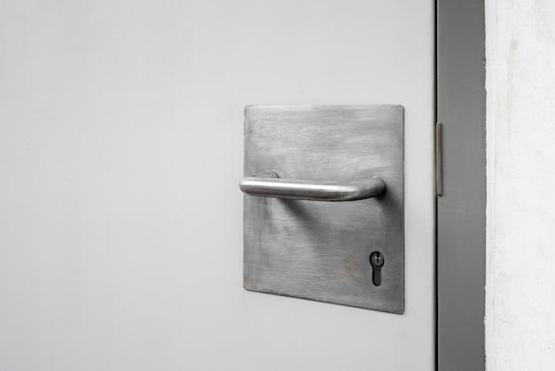 Steel handle and key with steel door in the city