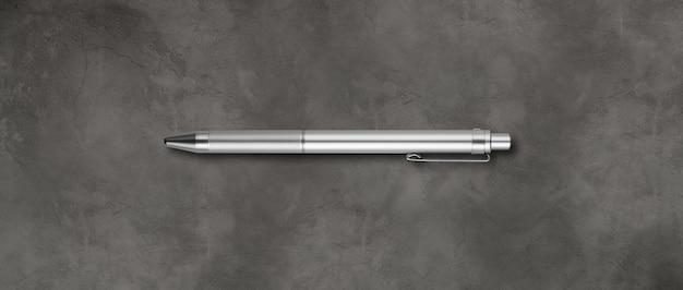 Steel metal pen isolated on dark concrete background